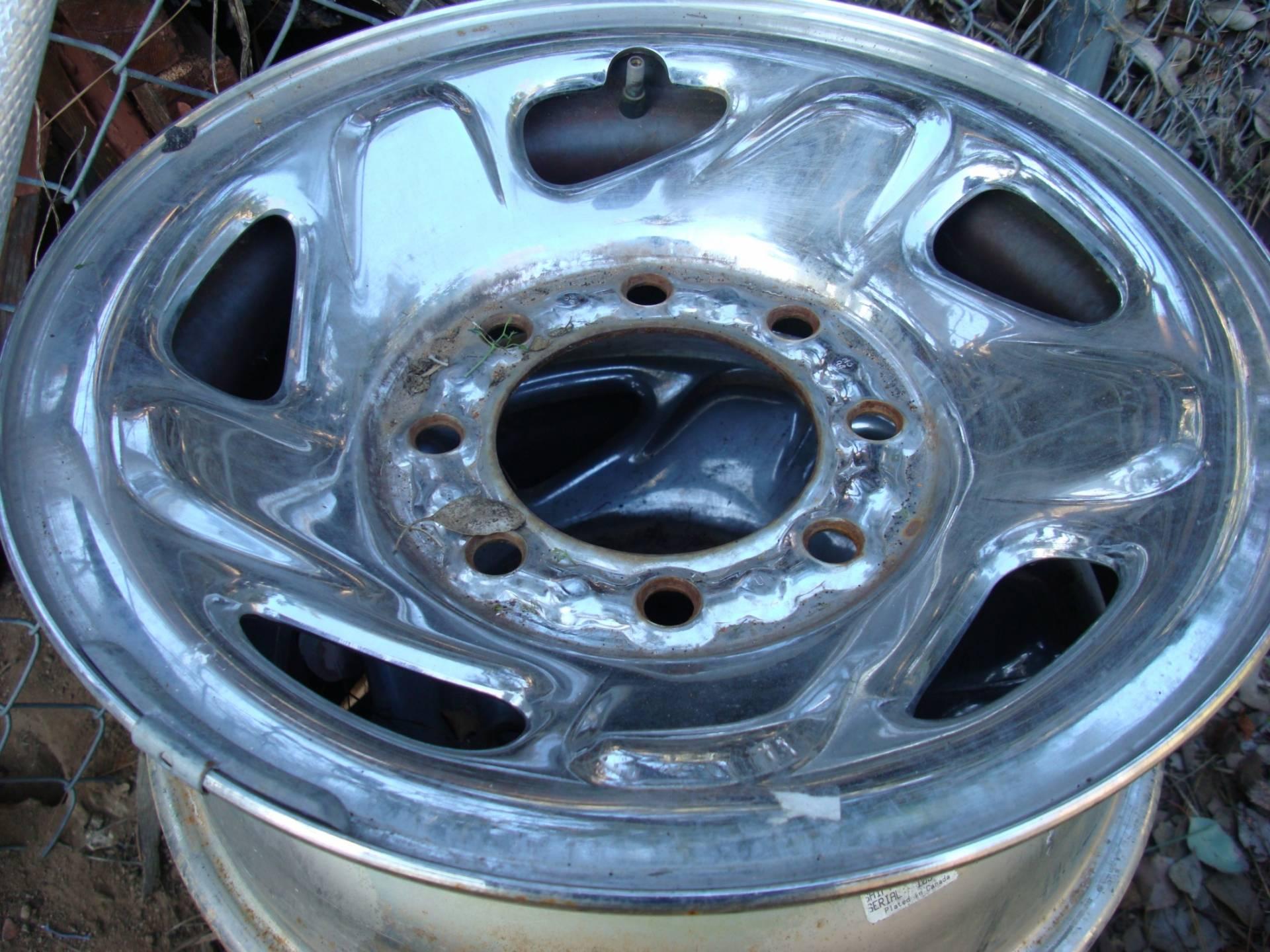 stock dodge 8 lug chrome rims and hub caps | Bloodydecks