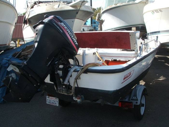 Complete with galvanized trailer25 HP Meck 4 cyc engine.Bait tankrod holderscanopy top2 6gal fuel tanksGPS fishfinderVHF radio. & boston whaler sport 13ft 2000 | Bloodydecks
