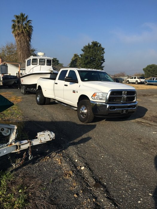 TRUCK AND BOAT IN FRONT YARD.jpg